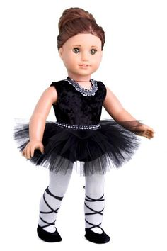 Black crash velvet leotard with silver trim around the neck. Tulle skirt with rhinestone ribbon at the waist. White cotton tights. Black matching ballet slippers with satin ties. - Ballerina outfit co