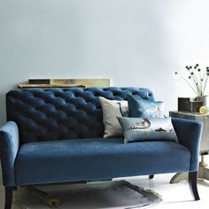 I love this sofa.  The jewel tone is amazing.  I think it'd be great in a room with gray walls.