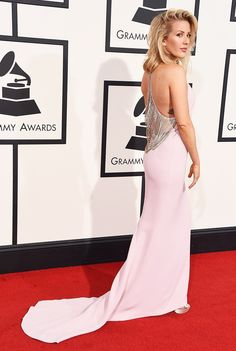 WHO: Ellie Goulding  WHAT: Nominee, Best Pop Solo Performance for Love Me Like You Do  WEAR: Stella McCartney bespoke blush V-neck gown with diamond drape detail; Bulgari jewelry and clutch; Jimmy Choo shoes.