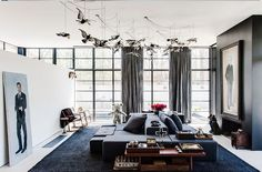 Black and White Living Room With Bird Sculptures