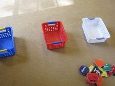 I happened by this classroom as the children were playing this simple little bean bag toss game. As each child walked up to the line, he or she would choose a bean bag out of the basket, then the teacher would ask the child to announce the color of the bag or name the letter …