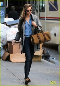 Miranda Kerr dons leopard print shoes while stepping out of her apartment