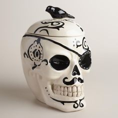 Our ceramic skull cookie jar is embellished with vivid details like a curved pencil moustache, a pirate's eyepatch, tattoo artwork and a bird-handle lid. >> #WorldMarket Halloween