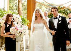 Revenge's Emily Thorne (Emily VanCamp) and Daniel Grayson (Josh Bowman) smile on their wedding day as Charlotte Grayson (Christa B. Allen) looks on.