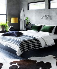 Love them green pillows, and the overall look of this place,with the grey brick-block walls... Ikea Bedroom