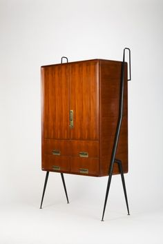 Stunning and rare highboard by Silvio Cavatorta, high quality craftsmanship made in Italy in the 1950's. The frame is made of lacquered iron, handles and feet are made of brass