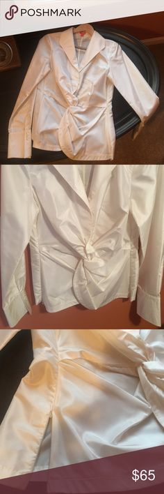 Gorgeous SILK fitted top This dressy cream colored silk blouse is well made.    Front twist adds detail.  Side zippers for easy dressing.   3 button cuffs.   I wish it fit me!!! eye Tops Blouses