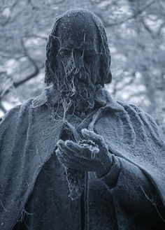 Frost clings to the statue of Lord Alfred Tennyson, Lincoln UK, by Christopher Furlong
