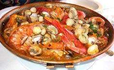Cataplana is a Portuguese seafood dish originating in the southern region of Portugal in Algarve, and it is about as traditional a Portuguese dish as you can get.