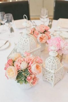 coral roses and white lantern wedding centerpiece