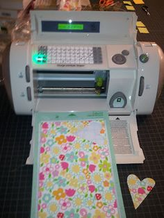 using cricut to cut fabric??? i didn't think it was possible.  not sure if my cheapo basic version will do it...