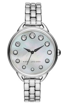 Free shipping and returns on MARC JACOBS Betty Bracelet Watch, 36mm at Nordstrom.com. An elegant wristwatch set in a stunning polished steel case features sparkling crystal indexes that mimic the moon cycles on the aura-invigorating pearl-esque dial.