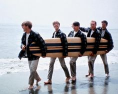 Sporting Pendleton board shirts, Dennis Wilson, David Marks, Carl Wilson, Mike Love and Brian Wilson of The Beach Boys go for a stroll on the beach in 1962.