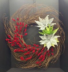 Today's simple Wispy Grapevine Holiday 2014 Season Wreath with faux red berries and wire meshed paper covered glitter winter white and mint green poinsettias!! Yup...All about Christmas mode now!!! Original Design & Arrangement by http://nfmdesign.synthasite.com/