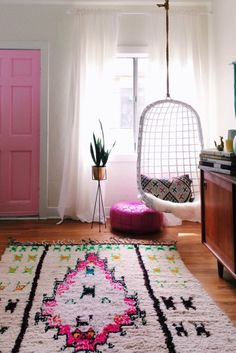 pink moraccan rug wicker swing chair