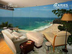 TERRENOS EN MAZATLÁN. Cuando se tiene una casa en la playa, siempre se tiene que aprovechar la vista que se tiene del mar. Se sugiere colocar grandes ventanales para poder apreciarla. Los muebles claros siempre le irán bien a espacios de descanso como la sala. GRUPO ARIES le dará todo tipo de facilidades para que sea un propietario más en LAS PUERTAS D' MAZATLÁN. http://grupoaries.com.mx/bienvenido/nuestros-desarrollos/