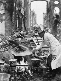 A chef cooks on the debris of his restaurant in Berlin, 1945