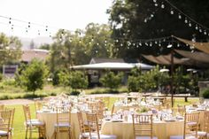 The wedding  reception was held outdoors in the beautiful garden of their venue. There is a real summer garden party vibe to the day with festoon lighting, mix matched table shapes, pastel blooms and laid back stationery. A gorgeous example of how to achieve a beautiful reception without being overwhelmed by fussy details.