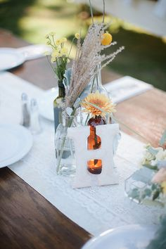 vintage letters as table numbers - photo by Nakalan McKay Photography http://ruffledblog.com/pacific-northwest-wedding-with-country-touches #weddingideas #tablenumbers #centerpieces