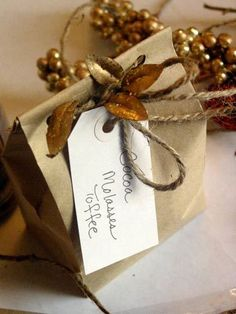 Not good at bow making? Need a creative wrapping idea for your Holiday food gifts? Try punching holes in a plain brown bag, tie with twine and then attach holiday colored foliage - real or artificial. (Oh, don't forget the gift tag!) Rustic and regal all at once.