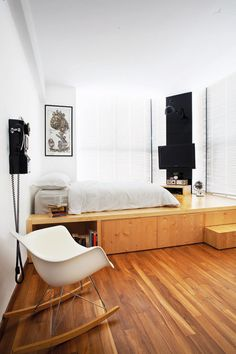 The sleeping platform, which takes up half the master bedroom incorporates storage space and even a bedside table.