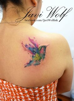 little flying bird watercolor tattoo on upper back - shoulder blade, feather