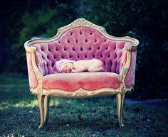 baby on velvet chair