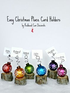 Mini Tree Stump Christmas Place Card Holders Tutorial: These colorful place settings are rustic and fun. To create them, attach winter ornaments to wooden stumps, adding wire to hold everyone's name. They'll *almost* look as good as the food. Christmas Place Cards, Noel Christmas, Christmas Balls, Christmas Ornaments, Diy Christmas Table Decorations, Christmas Table Settings, Christmas Place Setting, Christmas Buffet Table, Christmas Name Tags
