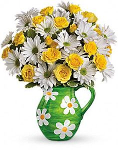 "I received these from a local teleflora florist -- GORGEOUS! Love daisies & the yellow roses were perfect with the pitcher/as a vase. <3 LOVE! Definitely make me happy/cheered me up & put a smile on my face! :)  (""Happy Daisy"" in a keepsake pitcher from teleflora.com )"