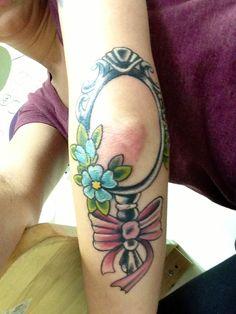 Elbow tattoo of a mirror. Hairdresser tattoos !