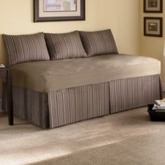 Love how they made a twin size bed look like a couch- Could I sew a cover like this? Make with a sturdier material.