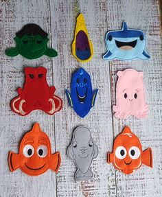 """This set of Finding Dory inspired finger puppets is ready to keep your child entertained for hours! These soft toys would be great for a road trip! Each puppet measures approximately 3.5"""" tall and is"""