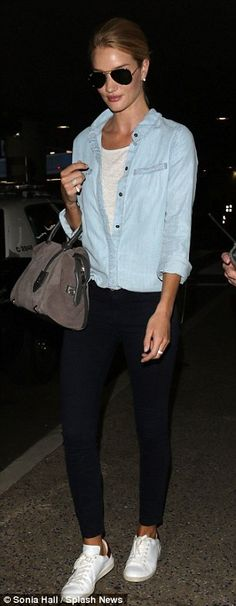 Double denim: The model swept her shoulder-length hair into a chic bun as she dashed through the airport