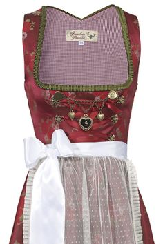Love the rich cranberry hue of, and pretty charms on, this wonderful dirndl. #dress #dirndl #German #folk #costume #traditional