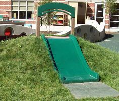 Hill Slide for your natural playground.  Wide slides are better & the mat is a good idea.