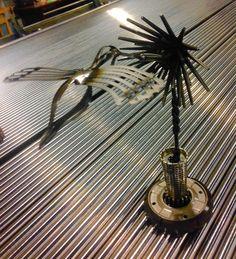 Steel flower, humming bird, metal art, assemblage art, welded art, kinetic art.