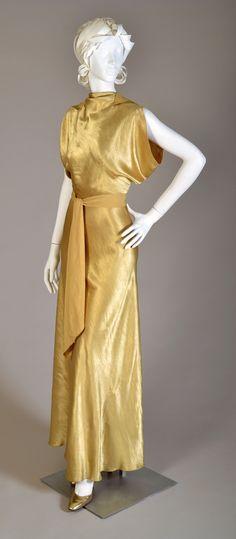 Evening Ensemble, American, circa 1935.  Gold rayon satin backed crepe: Full length gown, jacket, and sash. Gift of Mrs. Harry McDonald, KSUM.