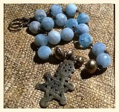 necklace - #aquamarine beads + old brass #tuareg bicone beads + brass #coptic cross