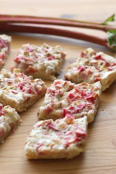 Rhubarb bars with a shortbread crust and tangy rhubarb custard filling are a fun, easy spring dessert. The buttery sweetness of the crust pe. Rhubarb Cookies, Rhubarb Bars, Rhubarb Desserts, Rhubarb And Custard, Spring Desserts, Just Desserts, Custard Filling, Delicious Desserts, Rhubarb Cobbler