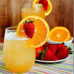 Skinny Sunrise is fresh orange and pineapple juice, homemade strawberry simple syrup, rum and club soda shaken with ice.