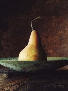 Single Pear in Bowl Photographic Print by David Jay Zimmerman at AllPosters.com