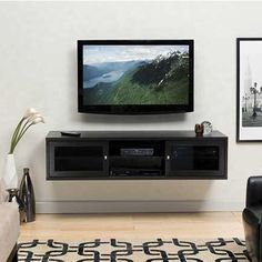 To float over base board heating: Sanus Java Series Dual-Purpose Lowboy TV Stand for Screens Up To 63 JFV60-E1