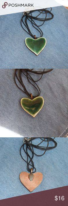 New Forest Green Heart Pendant Necklace This is a new handcrafted ceramic heart pendant necklace One of a kind, no two ever alike! Shiny Forest green in color with copper on back Fired in my kiln for durability, made from stoneware clay Attached bail, comes with cord necklace, 18 inch cord Approx 1 1/2 inches in size Will come with E Thorp Studios hang card E Thorp Studios Jewelry Necklaces