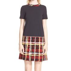 """MARC JACOBS Jersey Twill Pleated Dress A scrawled-chalk print and an exposed zip around the waist add rebellious attitude to a short-sleeve dress that pairs a twill-woven bodice with a pleated, tartan plaid skirt. 36"""" length. Partial back-zip closure. Jewel neck. Short sleeves. Unlined. 94% polyester, 6% polyurethane bodice; 64% triacetate, 36% polyester skirt and trim. Marc Jacobs Dresses"""