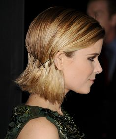 For short-haired girls of all textures, a row of crisscrossed bobby pins placed at ear-level looks hyper-chic and not I-did-this-on-the-train-with-restricted-elbow-room.   - MarieClaire.com