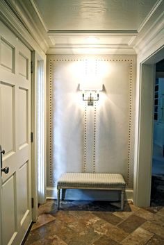 Upholstered entry wall with nailhead trim and stone flooring. Upholstered Walls, Furniture Upholstery, Upholstery Tacks, Upholstery Cleaning, Architecture Design, Home Decoracion, Small Entry, Entry Hallway, Upstairs Hallway