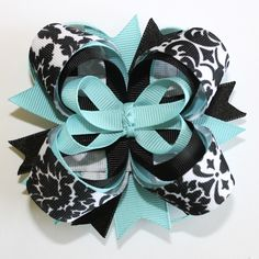 Awesome color combo here.  SALE...10% off by liking Lebelle Boutique on Facebook...Turquoise and Black Damask 4 Inch Stacked Boutique Hair Bow. $7.99, via Etsy.