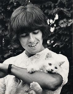 George smiles as Korky nibbles his arm