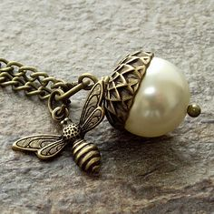 Cream acorn with bee charm pendant antique brass by jinjajewellery, £12.00