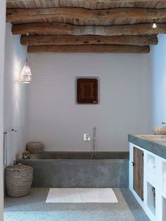Modern rustic bathroom with concrete looking bath and wooden planks in ceiling